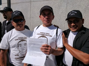 Luis Poot Pat, José Góngora Pat, and Carlos Poot Pat, delivering a speech for the one year and a half anniversary of Luis' death outside the Hall of Justice at 850 Bryant.